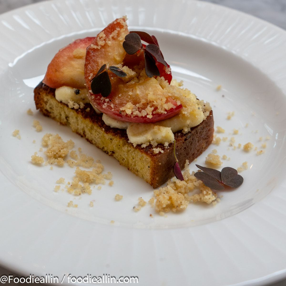 French toast Brioche, baked apple, vanilla cream, cardamom crumbs