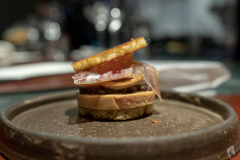 "Foie Gras ""au torchon"" with toasted brioche, crispy onion, house made charkuteries and date and black garlic puré."