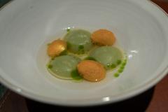 Ravioli with lovage and parmesan, served with tomato water and gently cooked tomatoes.