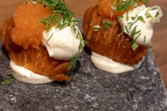Hasselback potatoes, bleak roe, sour cream and spring onions